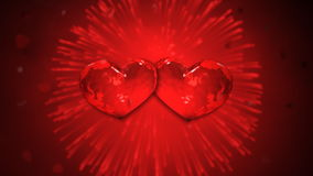 Heart to Hearts. Heart explodes with love to form two hearts against red background of fireworks stock footage