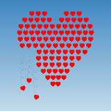 Heart to pieces. Heart made of little hearts that are falling Stock Photo