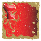 Heart to the St.Valentine. A pair of hearts with a gold branch on a red background Stock Image
