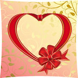 Heart to the St.Valentine. Heart with bow from red ribbon  on a yellow background Stock Photography