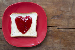 Heart toast on red Royalty Free Stock Image