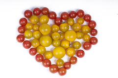 Heart from tomatoes Stock Photos