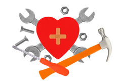 Heart and tools. Concept: Renovation of heart. Stock Photos