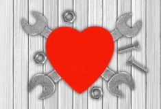 Heart and tools over wooden background. Concept: Renovation Royalty Free Stock Photos