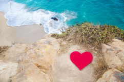 Heart on the top of hill next the ocean Stock Photos