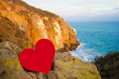Heart on the top of hill next the ocean Royalty Free Stock Photography