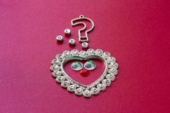 Heart with toy eyes, question mark and the inscription Love royalty free stock photo