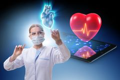 The heart treatment in telemedicine concept. Heart treatment in telemedicine concept royalty free stock photo