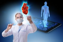 The heart treatment in telemedicine concept. Heart treatment in telemedicine concept stock photos