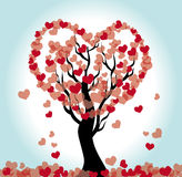 Heart tree. Black tree with falling leaves in form of hearts Stock Image