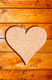 Heart in a tree trunk on cork background. Love Royalty Free Stock Photography