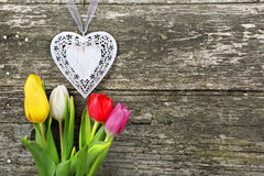 Heart and tulips on Valentines Day on wood background Stock Photo
