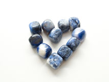 Heart of Tumbled jasper stones for crystal therapy treatments an. D reiki close up Stock Photography