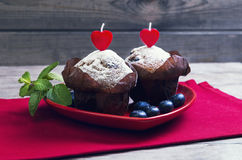 Heart with two berry muffins Stock Images