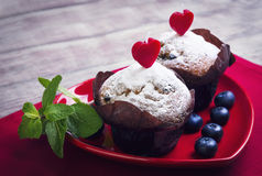 Heart with two berry muffins Royalty Free Stock Image