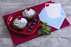 Heart with two berry muffins Stock Photo