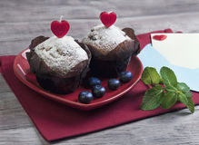 Heart with two berry muffins Stock Photos