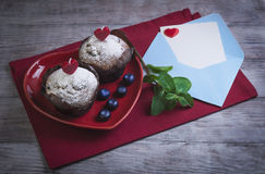 Heart with two berry muffins Stock Image