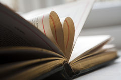 Heart from two book pages Stock Images