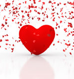Heart under confetti. Red iconic heart under confetti rain Royalty Free Stock Images