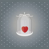 Heart under glass heart on with white ribbon on a gray background Stock Photo