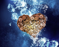 Heart under water. Gear heart sink in clear blue water royalty free stock photography