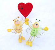Heart - Valentine and butterfly in the snow Stock Photos