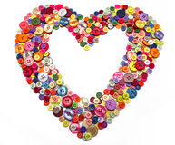 Heart of various sewing buttons, knobs Stock Photos