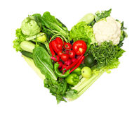 Heart of vegetables. Pile of vegetables shaped as heart isolated on white background Stock Photography