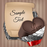In the heart with very chocolate ribbon foil and paper sheet Stock Image