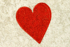 A heart on a vintage playing card. Royalty Free Stock Images