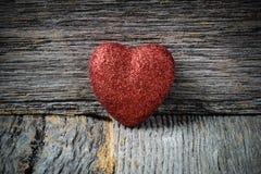 Heart on Vintage Wood Background stock photo