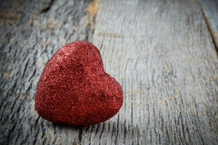 Heart on Vintage Wood Background stock photography