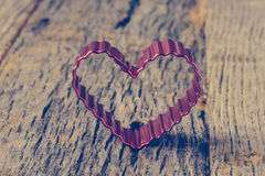 Heart on Vintage Wood Background royalty free stock image