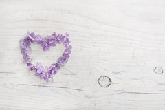 Heart of violet or blue lilac blossom on white shabby wooden Stock Photo