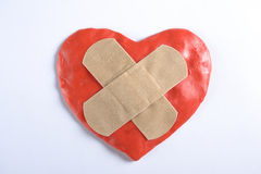 Heart vith medical tape Stock Images