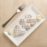 Heart waffles lemon zest, powdered sugar served on rectangular p Royalty Free Stock Photography
