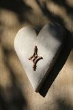 Heart. A wall mounted décor addition, concrete heart. Adding warmth to a venue or home, a symbol of love. Can also imply cold hearted, the end of a relationship Stock Photo