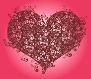 Heart wallpaper. Heart shape filled with a floral pattern Royalty Free Stock Photo