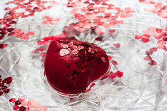 Heart in the water. Background of water. Stock Photos