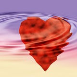 Heart in water graphic. Red heart in water with ripples background Stock Image