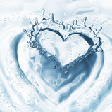 Heart from water splash with bubbles on blue water background Royalty Free Stock Images