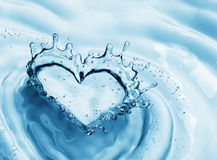 Heart from water splash with bubbles on blue water background. 3d rendering Royalty Free Stock Image