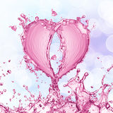 Heart from water splash with bubbles Stock Photos