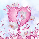 Heart from water splash with bubbles Royalty Free Stock Image
