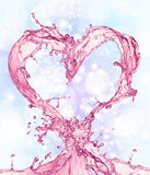 Heart from water splash with bubbles Stock Photography