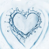 Heart from water splash with bubbles isolated on white Stock Image