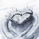 Heart from water splash with bubbles isolated on white Royalty Free Stock Images