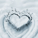 Heart from water splash with bubbles isolated on white Royalty Free Stock Image