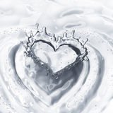Heart from water splash with bubbles isolated on white Royalty Free Stock Photo